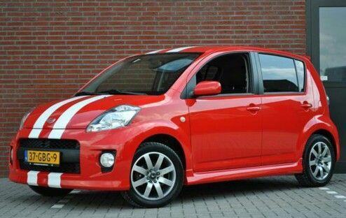 Red Daihatsu Sirion Sport with white stripes