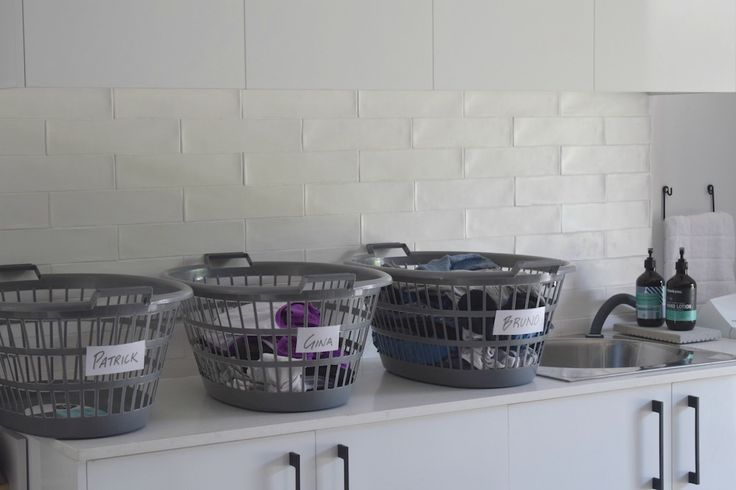 These washing baskets aren't for dirty washing. It's a home organisation hack to give each member of the household a washing basket with their name on it. It becomes their responsibility to put their clean clothes away and bring their dirty clothes to the laundry. Let's see how successful it is!