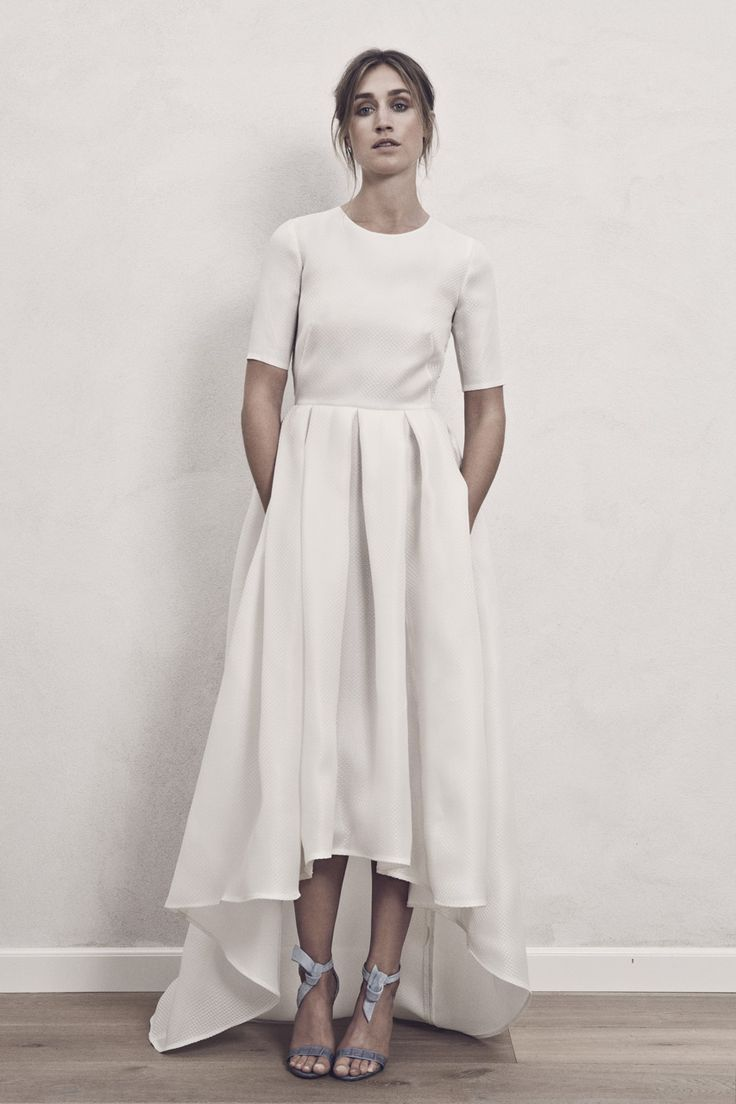 High-low Nordic chic and cool wedding dress with pockets. Carrie Bradshaw would wear this dress.