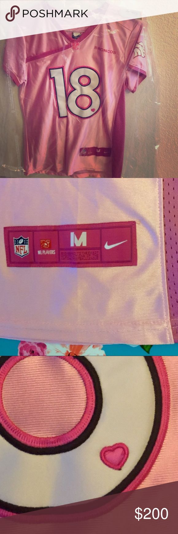 Cute!! Pink Payton manning jersey Priced for offers - just ask 💗 Worn only a handful of times! Authentic, pink Payton manning jersey. Dry cleaned last season and been hanging in the dry cleaning bag since. Super cute, flattering fit!!!! Unique color & hearts on front and back logo 💗 size med Nike Tops