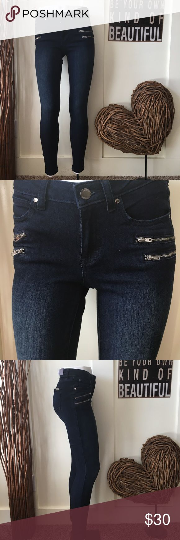 Jennifer Lopez skinny jeans with zippered pockets Jennifer Lopez skinny mid rise jeans are slim through the hip and thigh , skinny leg opening with stretch for comfort.  Silver tone zippered pockets on the front make these jeans a must have. Jennifer Lopez Jeans Skinny