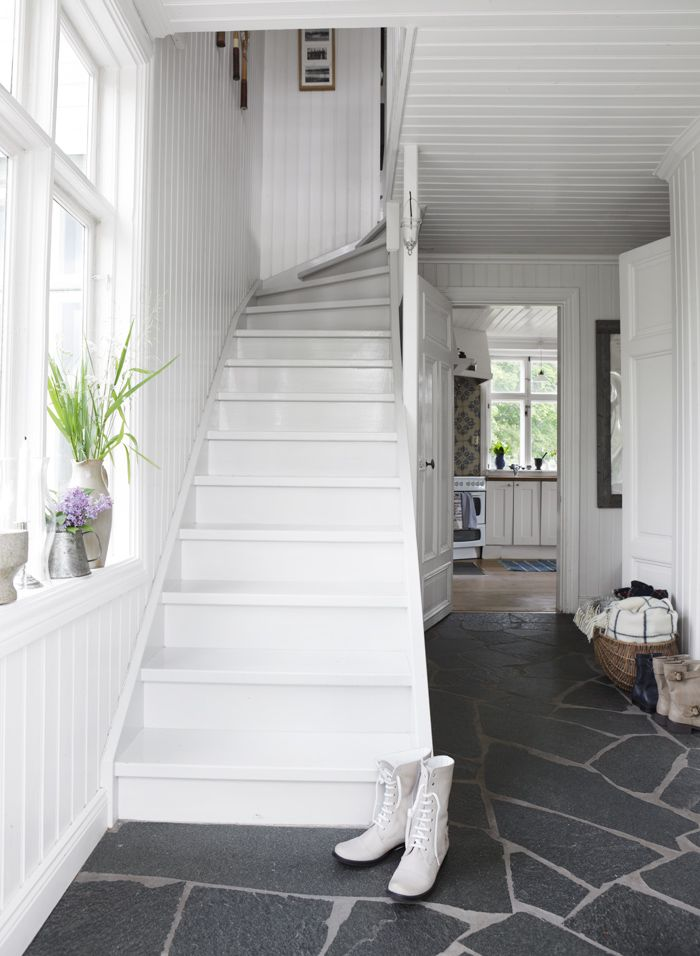 white staircase and entrance hall