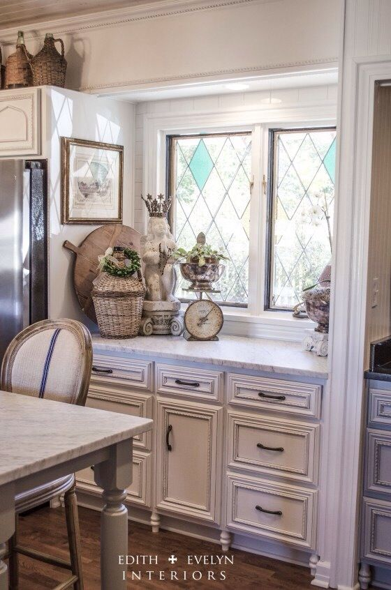 Cabinets painted Snowbound by Sherwin Williams then glazed with Valspar's Antiquing Glaze in Aspaltum