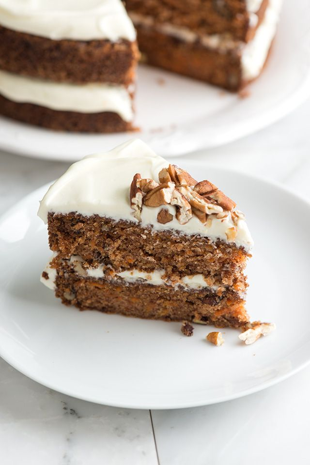 An incredibly moist and light carrot cake recipe with extra simple cream cheese frosting. A must make! From inspiredtaste.net | @inspiredtaste