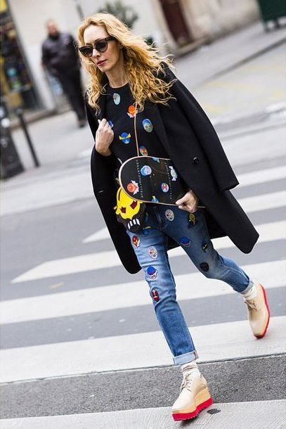 See our Stellasuperheroes jumper, denim and accessories from the Spring '15 Stella McCartney collection spotted on Elina Halimi in her Paris street style look.   Photo courtesy of @elina_halimi> instagram.com/elina_halimi
