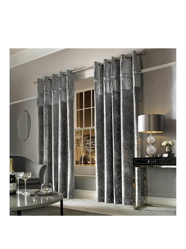 Kylie Minogue Veda Lined Eyelet Curtains in 3 size options Bring the wow-factor to your windows with the sumptuous style of these stunning lined curtains, designed by the princess of pop herself, Kylie Minogue. Made with contemporary room settings in mind, they're lovingly crafted from silver-toned crushed velvet, injecting a real feeling of glamour into your space. A series of sparkling jewels are perfectly placed across the pintuck header, giving them a breathtaking finishing touch. With…