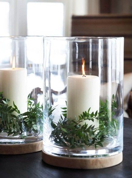 Ferns and pillar candles in glass hurricanes, maybe add some lovely white flowers