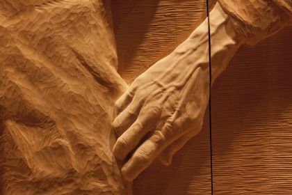 """The """"Wall In the Wilderness"""" at Derwent Bridge in Tasmania, a decade long sculpture project by Greg Duncan who is carving  history in a wall on Huon Pine."""