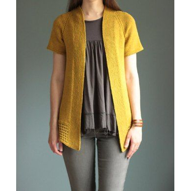 """Passing Showers is an open-style short sleeved cardigan using dk-weight or light worsted-weight yarn. It is knit in one piece from the top-down and featuring A-line body shaping. An eyelet stitch pattern is featured on the back as well as along the bottom hem and stitches are picked up to create the front bands. An easy layering piece perfect for warmer weather!Pattern Information:Sizes: XS (S, M, L, XL, 2X, 3X, 4X)Shown in size S, being worn with approx. 2""""/5 cm of positive ease.Chest…"""