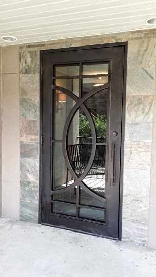 We're sure this contemporary style wrought iron single entry door will get the modern homeowner's seal of approval.  doors. entry doors.  front doors.  iron doors. wrought iron. curb appeal. dream home. home building. home remodel.
