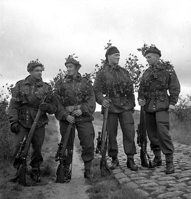 Scout personnel of the Queen's Own Cameron Highlanders of Canada (?). These men have killed a total of 101 men through sniping operations. 9 Oct 1944, Camp de Brasschaet, Belgium.
