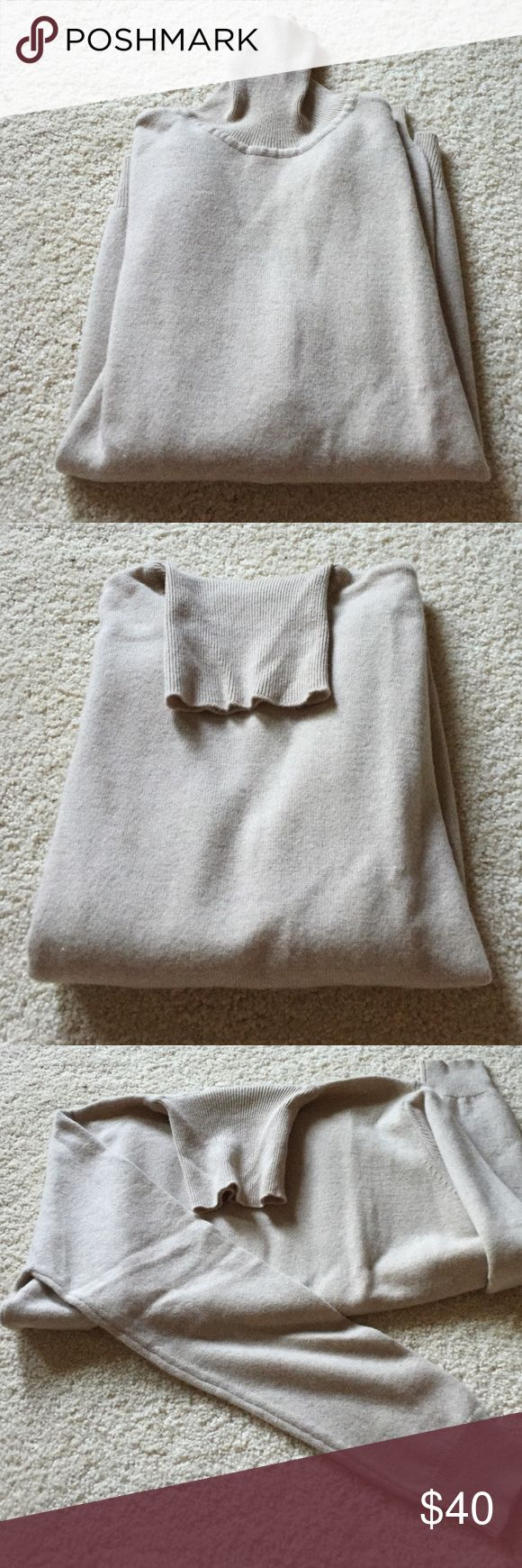 """Country Shop Cashmere Sweater Excellent condition. 100% cashmere. Thick and soft. Long sleeves, turtleneck. Banded sleeves and bottom edge. Beige. Not from a smoke free house. Dry clean only. 19"""" armpit to armpit. 23.5"""" long from shoulder. Country Shop Sweaters Cowl & Turtlenecks"""