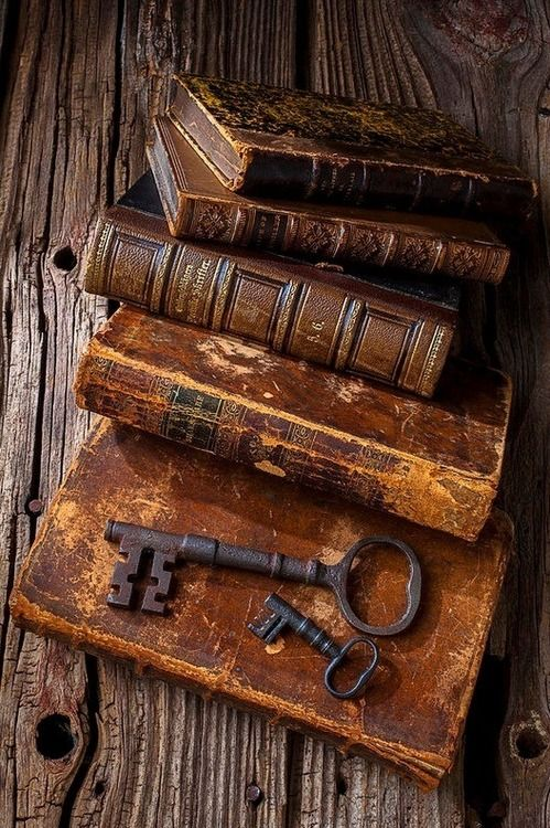 'old keys and books' quoted by previous pinner vintage leather bound books and rustic rusty vintage keys steam punk pirates sailing ship high seas