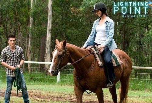 horse riding - lightning-point Photo