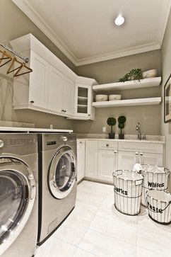 Laundry Never Seemed so Fun | Pattern Fanatic. Classic grey and white laundry room with shiny chrome accents. Always good.