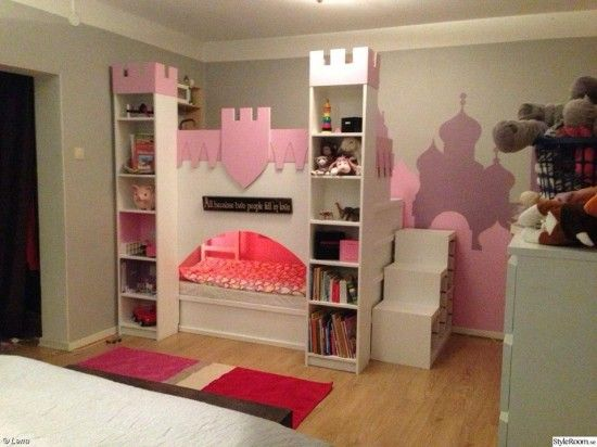 Castle bed with upper play deck using an IKEA Kura bed and two Billy bookcases