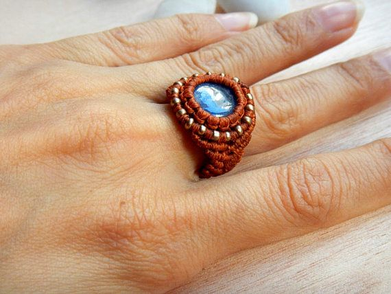 A gorgeous Blue Sapphire macrame ring that catches everybodys eyes! It is unique and one of a kind.  This ring is made with micro macrame technique and has a stunning precious stone that glows under light. It is combined with red brown waxed cord 1mm of premium quality and some tiny glass seed beads 2mm in a beautiful bronze color. The rings size fits to 7 - 7 1/4 US but can fit also in a little bigger sizes, reaching the 8 US. That is because in bigger sizes can get more loose after a w...