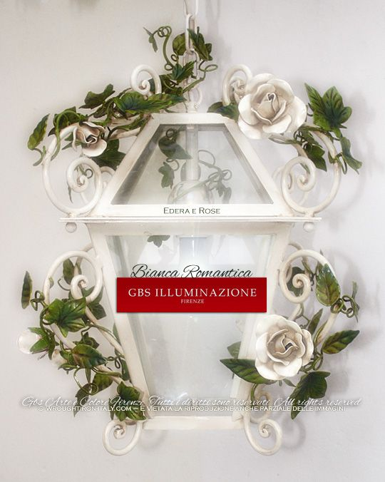 Ivy and roses, wrought iron white lantern  Romantic lantern with white roses. Ivy and roses, wrought iron lantern with forged spirals, while with gloss paint. Made in Florence. GBS lighting fixtures are designed and made entirely in Florence, produced in GBS factory there using only top-quality Italian components. Made in Italy. Design: Gianni Cresci