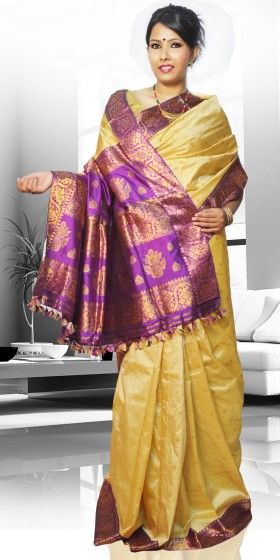 Beautiful Golden Colour Pat Guna Contrast Assam Silk Saree with artistic Guna work giving an unique look to the collection. This saree can be used as both wedding and festival Saree.The Saree comes with matching blouse piece, the blouse shown in the image is just for display purpose.Slight colour variation may be there in display & actual.