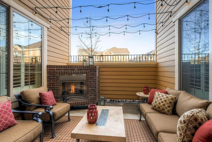 """Transitional Patio with 70"""" Klismos Classic Sofa, Edison Bulb String Lights, Marco Coffee Table by Summer Classics"""