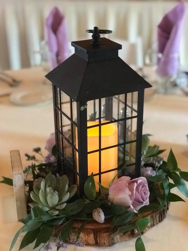 Beautiful Floral Centerpiece With Maneeley S Lantern And Wood Slab By Bella Flora Wood Slab Centerpiece Wedding Floral Centerpieces Wedding Table Centerpieces