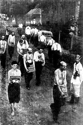 On starvation rations, Jews were forced to carry loads of bricks. Poland