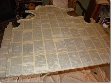 Cardboard headboard covered in book pages. Tutorial.
