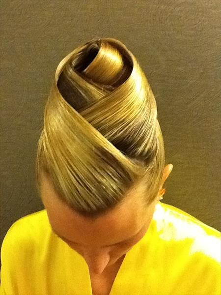 High bun with layered wraps . Good hairstyle for standard. Visit http://ballroomguide.com/comp/hair_make_up.html for more hair and makeup info