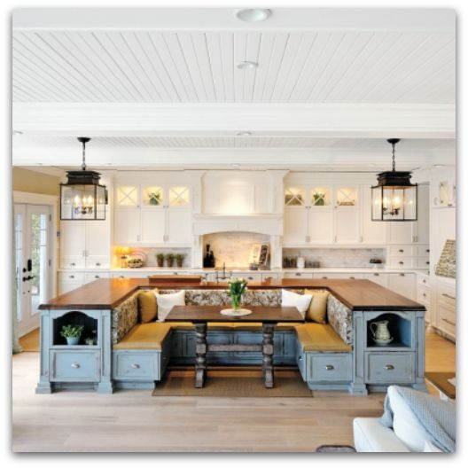 Island with built-in seating in this cape cod styled kitchen :: I love to dream about my next kitchen. It may or may not happen... but a girl can dream. And this collection of kitchen deliciousness is sure to tantalize your kitchen taste buds. Grab your cup and come along for some wonderful inspiration.