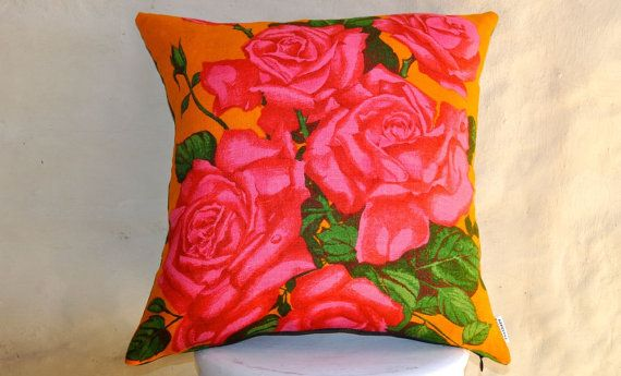 Eye popping roses to liven up any room! This double sided cushion has hot pink roses on an orange background, with denim on the back.