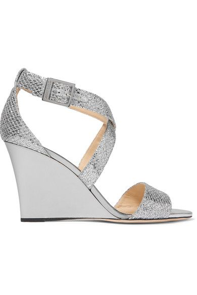 FALLPROOF, FOOLPROOF: Jimmy Choo's 'Fearne' sandals chime perfectly with this season's penchant for metallics. They've been crafted in Italy from silver glittered leather and have a mirrored wedge heel – comfortable enough for evening-long wear. We like how the crossover straps elegantly follow the contours of your feet.