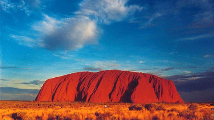 Ayer Rock, Australia, 1,142 feet high and the base 5 miles around... Amazing!