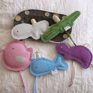 Pacifier Holder: A cute and practical idea. Made of 100% linen with polyester filling and a sturdy metal clasp sewn to the back.