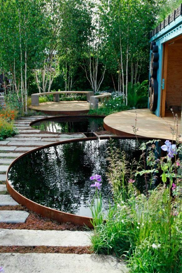 This is another example of how to create a beautiful rounded patio/sitting area that can keep with the consistent shape of teapots. The water features may be different from what the client is asking for, plus it is not a fountain and unsafe for small dogs; however, the seating area in the back represents a beautiful style option that the clients can incorporate into their landscape.