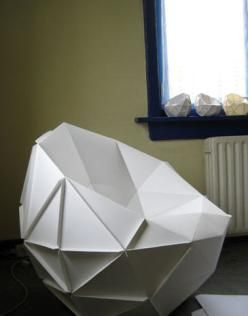 Gosi. A chair constructed out of paper.  All that Gosi wants is to become a regular chair one day. Jon Bjornsson