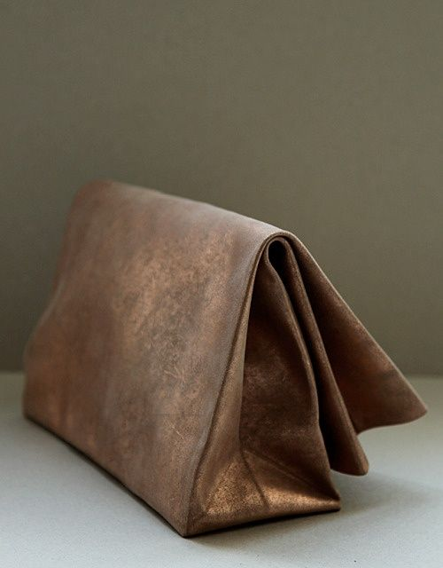 Paper bag clutch made by hand from a single piece of fine suede