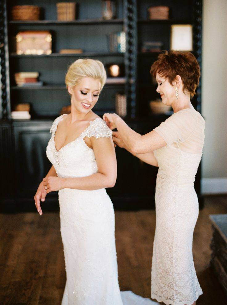 Photography: Graham Terhune Photography - http://www.stylemepretty.com/portfolio/graham-terhune-photography Wedding Dress: Maggie Sottero - maggiesottero.com   Read More on SMP: http://www.stylemepretty.com/2015/05/25/elegant-emerald-gold-military-wedding/