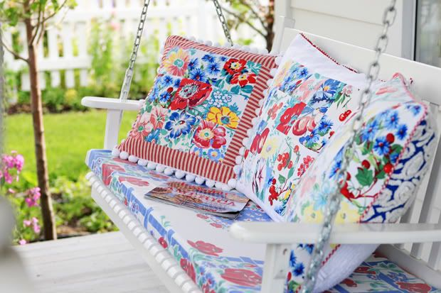 porch swing with pillows made from vintage tablecloths ~ Meadowbrook Farm: summer afternoon