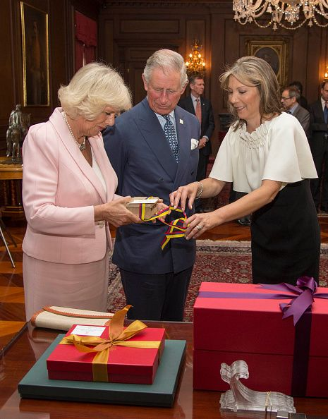 October 29, 2014 - Camilla and Charles with First Lady of Colombia, Maria Clemencia Rodriguez Munera exchange gifts at a reception at the British Ambassador's residence for Colombian Business people and members of the British community in Bogota, Colombia