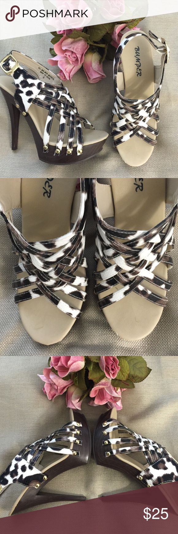NWOT Bumper strappy animal print heeled sandals. Super sexy!!! NWOT Bumper strappy heeled sandals. Animal print faux snake. One tiny flaw on left shoe where toes would be. A mystery as they have never been worn. Hard to see. Heel is sky high measuring 5 inches. Platform measures 1 & 1/2 inches. WOW!!!! Bumper Shoes Heels