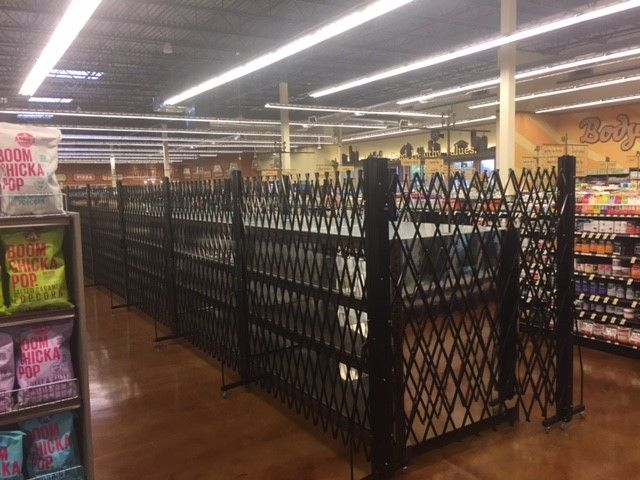liquor aisle access control. Xpanda portable powder coated gates easily rolled into place when needed, and rolled away for storage when not needed
