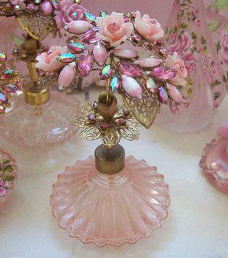 Irice perfume bottle with aurora borealis rhinestones, roses, & filigree