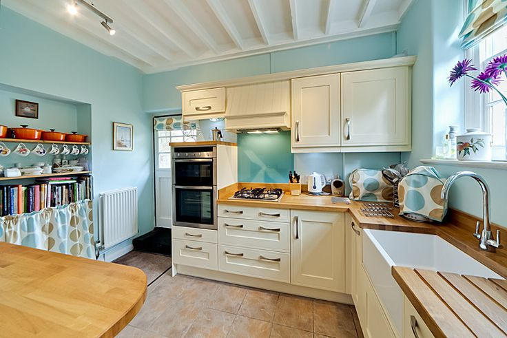 Beautiful Kitchen With Cream Units And Wooden Worktops