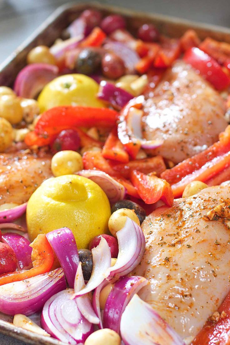 Chicken, peppers, onions and little baby potatoes all roasted up in a yummy quick marinade! Topped with feta and kalmatas. Such big flavor for a healthy and quick meal! Thislast