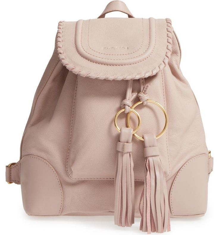The double ring- and tassel-tipped drawstrings really make this supple leather backpack shine.