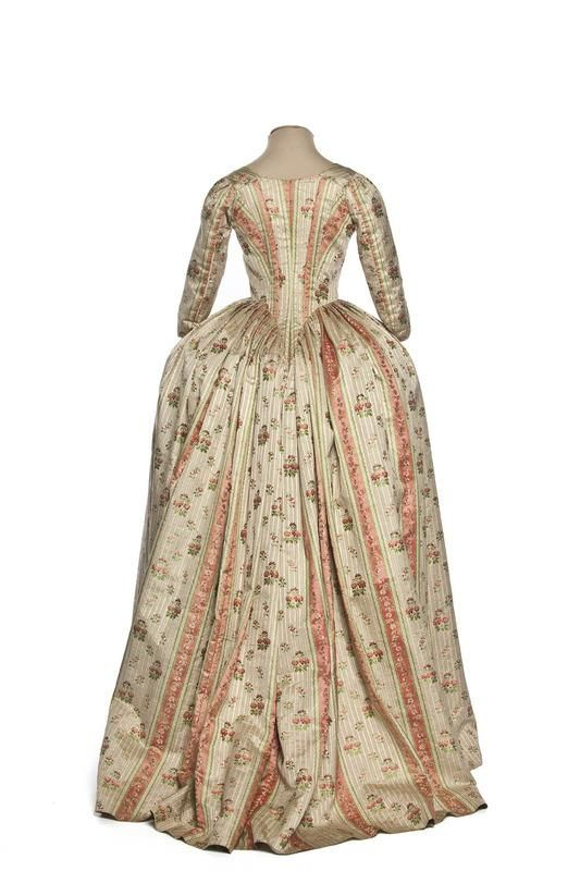 Back view, robe à l'Anglaise, France, 1780-1785. Cream and pink striped silk with floral motifs.