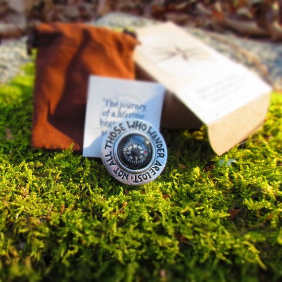 Our Not All Who Wander Are Lost pocket compass is handcast in solid, lead-free pewter in our studio in Coventry, RI. Each compass is signed by the artist, Jim Clift. The compasses arrive packaged in one of our signature chocolate brown felt bags. A perfect gift for a loved one who is far