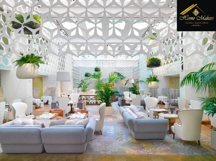A luxury hotel cafe designed by Home Makers. All white marks luxury and fresh plants give a feeling of lush green! The design is made by professionals at Home Makers Interior Designers And Decorators Pvt. Ltd.  www.homemakersinterior.com
