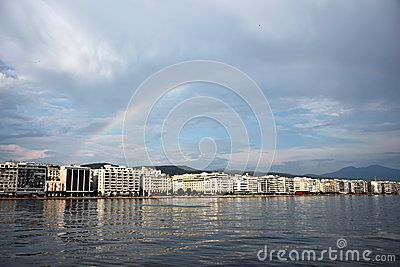 A seaside view of Thessaloniki with a rainbow above her