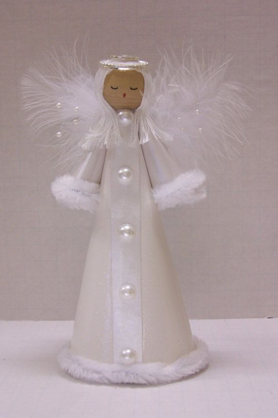 The angel is made from white sateen card stock and trimmed with white pipe cleaners, faux pearls go down the front of the angel. The base is